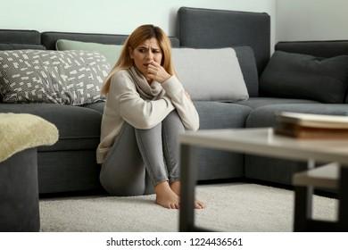 Woman having panic attack at home