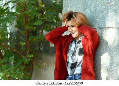 Woman having panic attack outdoors