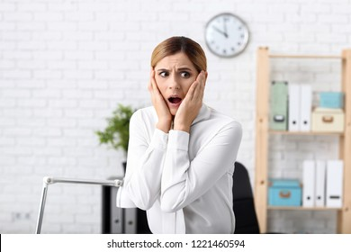 Woman having panic attack at workplace