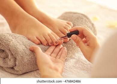 Woman having pedicure at salon