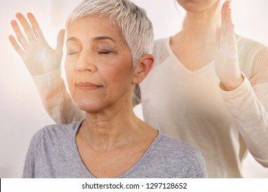 Woman having reiki healing treatment , alternative medicine concept, holistic care