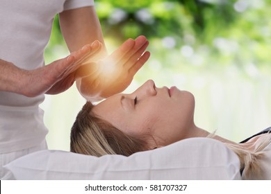 Woman having reiki healing treatment , alternative medicine, holistic care concept.