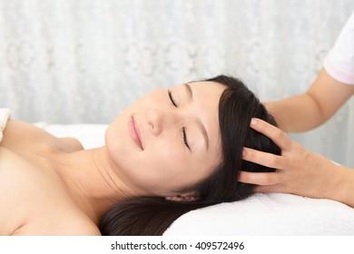 Woman having relaxing massage in spa salon