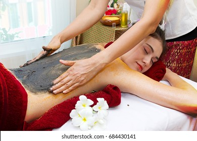 Woman is having scrub by salt in day spa
