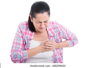 Woman having severe chest pain as heart attack and illness concept isolated on white background