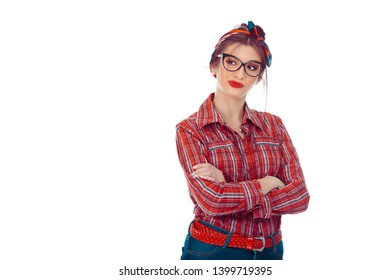 Woman having skeptical and dissatisfied look expressing Distrust, skepticism and doubt. Closeup portrait of a beautiful girl in red checkered shirt, jeans with retro bow on head isolated on pure white