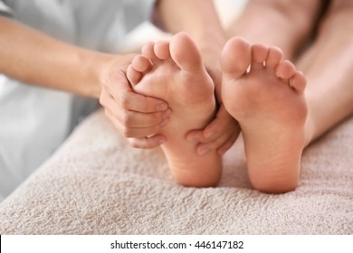Woman having spa massage on her feet at beauty salon