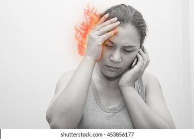 Woman headache - dizziness.Concept photo with Color Enhanced pale skin with Fire indicating location of the pain.