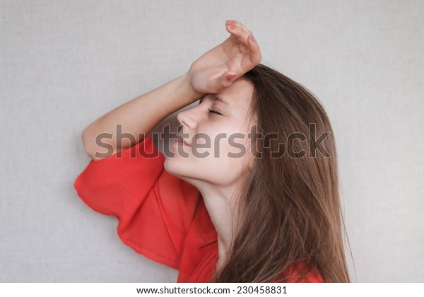 Woman with headache holding head with hands