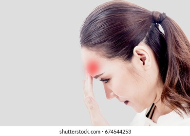 Woman headache and holding head on gray background