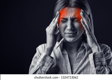 Woman with headache. Medical concept. Black and white photo
