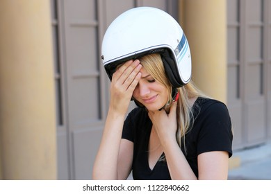 Woman with headache on scooter