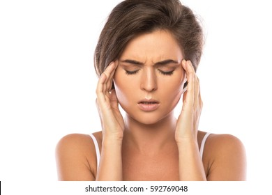 Woman with a headache on white background