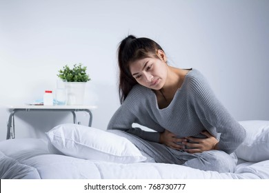 Woman headache and sick on the bed