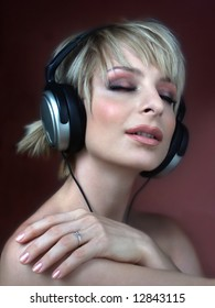 Woman with headphone listening music