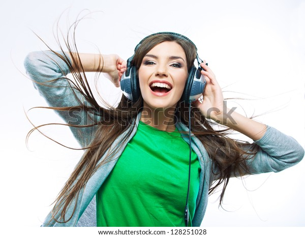 Woman with headphones listening music . Music teenager girl dancing against isolated white background. Teen life style concept.