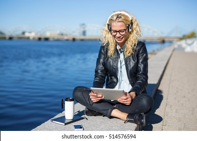 Woman with headphones using tablet