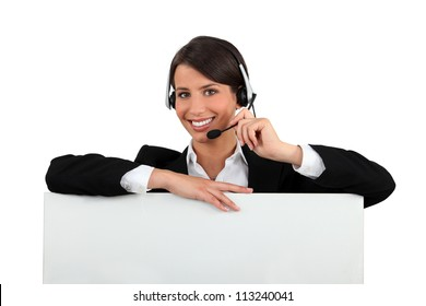 Woman with a headset and a board left blank for your message