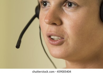Woman with headset. High resolution photograph depicting call center or helpcenter worker.
