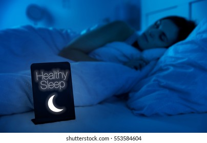 Woman healthy sleeping in bed at night