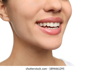 Woman with healthy teeth and beautiful smile on white background, closeup. Cosmetic dentistry