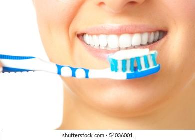 Woman healthy teeth closeup brushing concept