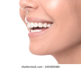 Woman with healthy teeth on white background, closeup