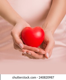Woman with heart in hands, give love, valentine's day, closeup