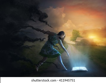 A woman is held back by the darkness while reaching for a glowing Bible.
