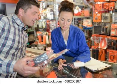 woman helping customer in warehouse