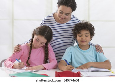 Woman helping kids with homework