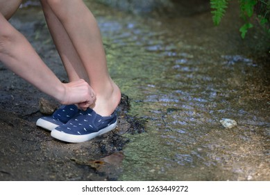 woman helps a child shoe sneakers