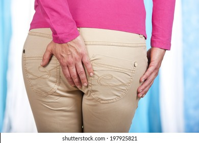 Woman with hemorrhoids