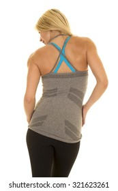 a woman with her back to the camera in her fitness clothing.