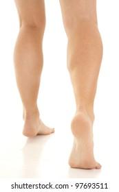 A woman in her bare feet walking away.