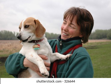 Woman with her beagle at the park