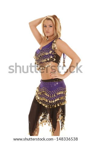 3ad6f605a A woman in her belly dancing clothing with a serious expression on her face.