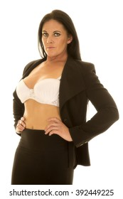 A woman in her black suit, with the top open, showing her bra.