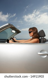 Woman and her cabriolet car at beach
