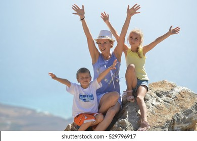 woman with her children on top of mountain