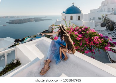 Woman with her daughter on Santorini Island, Cyclades, Greece
