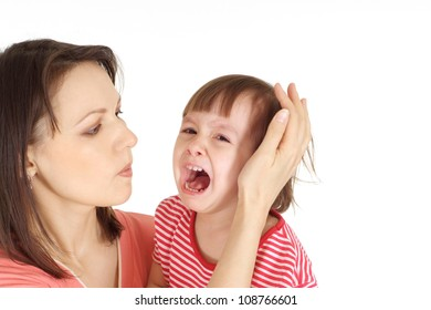 Woman and her daughter in a red sweater on a white background