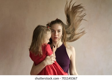 Woman and her daughter taking selfie