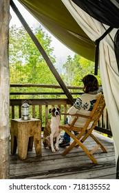 Woman and her dog Glamping