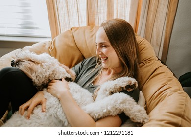 Woman and her dog at home
