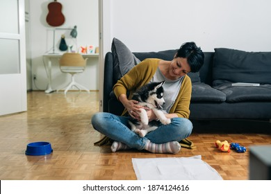 woman with her dog at home