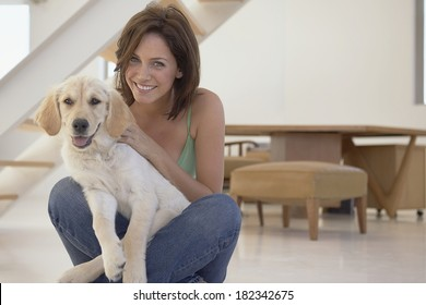 Woman  and her dog in the house