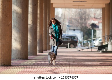 woman and her dog taking a walk