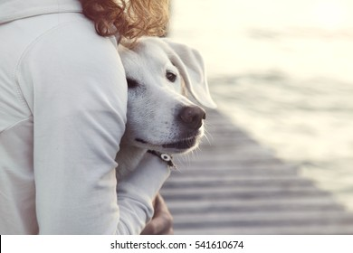 woman and her dog together outdoors