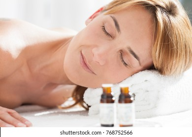 woman with her eyes closed on a massage table
